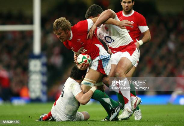 Wales' Andy Powell is tackled by England's Harry Ellis and Nick Easter during the RBS 6 Nations match at the Millennium Stadium Cardiff