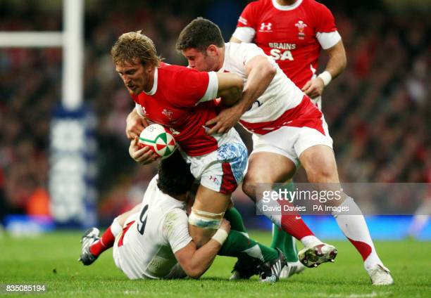 Wales Andy Powell is tackled by England's Harry Ellis and Nick Easter during the RBS 6 Nations match at the Millennium Stadium Cardiff