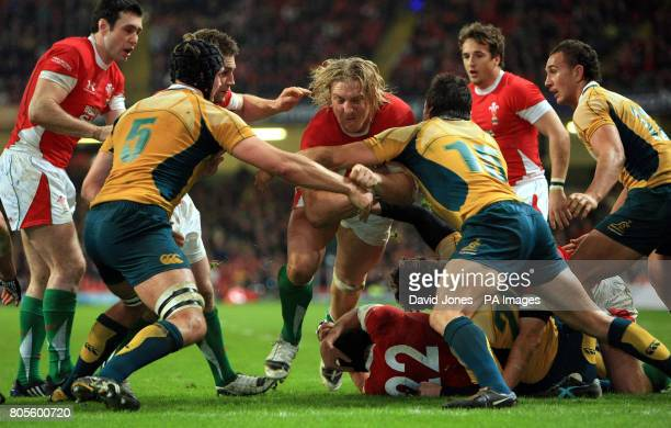 Wales Andy Powell is tackled on Australia's tryline by Dean Mumm and Adam AshleyCooper during the Autumn International match at the Millennium...