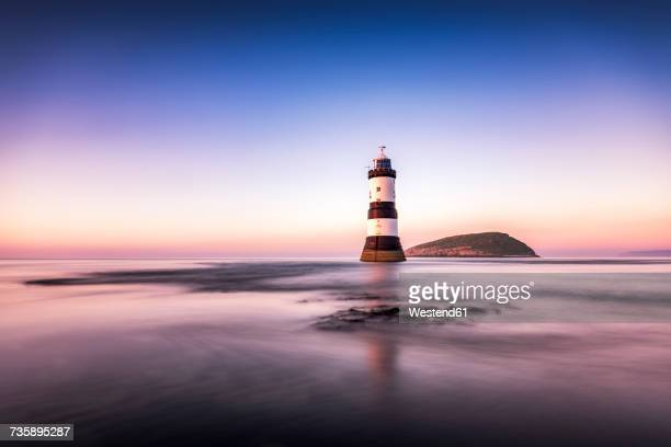 UK, Wales, Anglesey, Penmon, Dinmor Point, Trywn Du Lighthouse with Puffin Island in the background