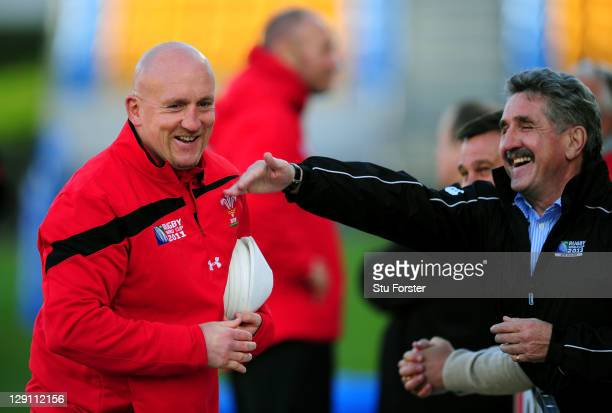 Wales assistant coach Shaun Edwards shares a joke with former Wales and British Lions wing Gerald Davies during a Wales IRB Rugby World Cup 2011...