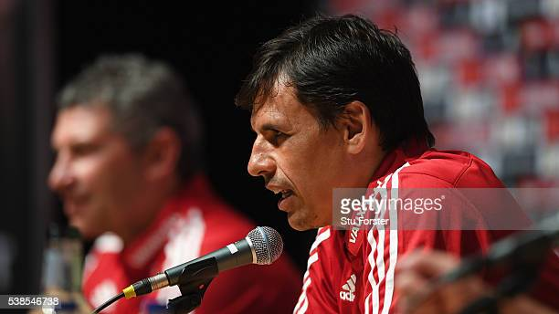 Wales assistant manager Osian Roberts and manager Chris Coleman face the media at a press conference at the Wales Euro 2016 press centre on June 7,...