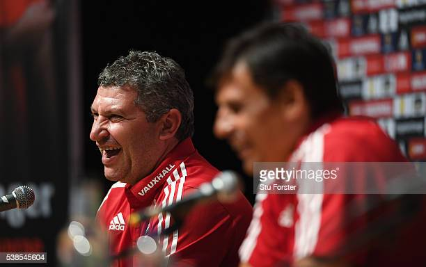 Wales assistant manager Osian Roberts and manager Chris Coleman share a joke as they face the media at a press conference at the Wales Euro 2016...