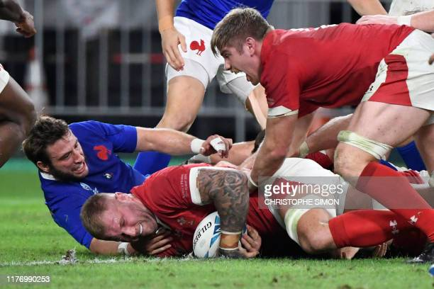 Wales' back row Ross Moriarty scores a try during the Japan 2019 Rugby World Cup quarterfinal match between Wales and France at the Oita Stadium in...