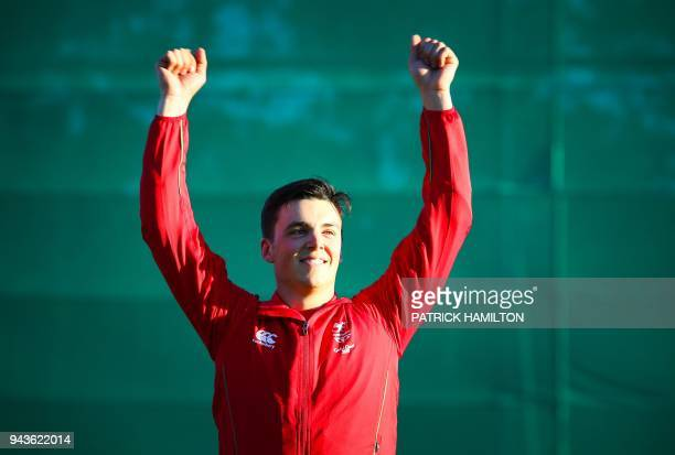 Wales' Ben Llewellin reacts following the skeet men's shooting medal ceremony during the 2018 Gold Coast Commonwealth Games at the Belmont Shooting...