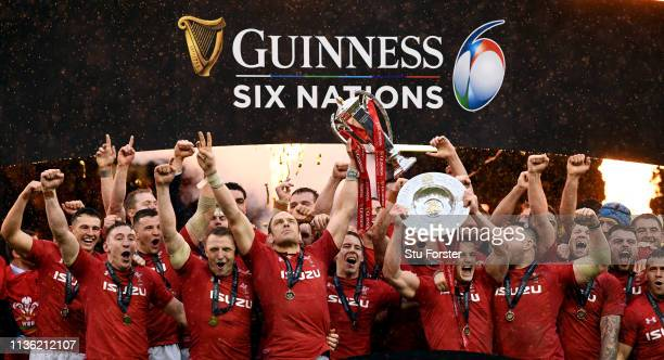 Wales captain Alun Wyn Jones and team mates celebrate with the Championship trophy after winning the Grand Slam after the Guinness Six Nations match...
