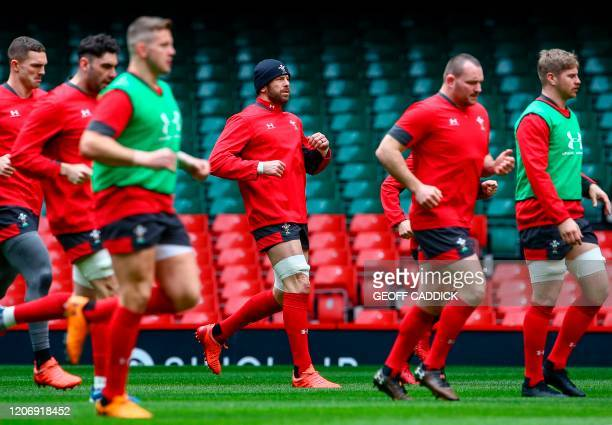 Wales' captain Alun Wyn Jones participates in the captain's run training session at the Principality stadium in Cardiff, south Wales on March 13 on...