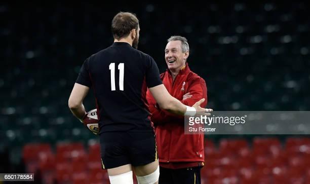 Wales captain Alun Wyn Jones shares a joke with head coach Robert Howley during Wales captain's run ahead of their RBS Six Nations match against...