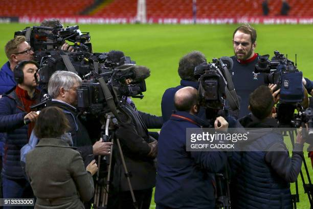 Wales' captain Alun Wyn Jones talks to members of the press pitchside after a training session at the Principality Stadium in Cardiff south Wales on...