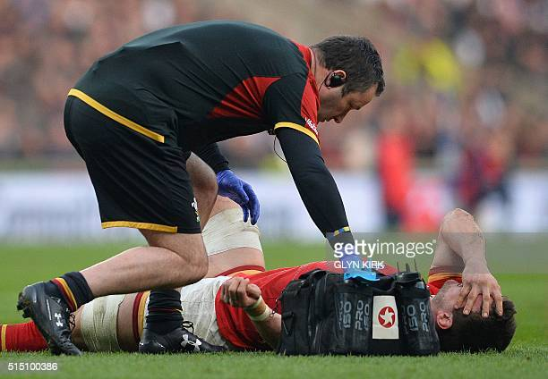 Wales' captain and flanker Sam Warburton receives medical attention after picking up an injury during the Six Nations international rugby union match...