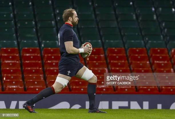 Wales' captain and lock Alun Wyn Jones stretches during a training session at the Principality Stadium in Cardiff south Wales on February 2 ahead of...