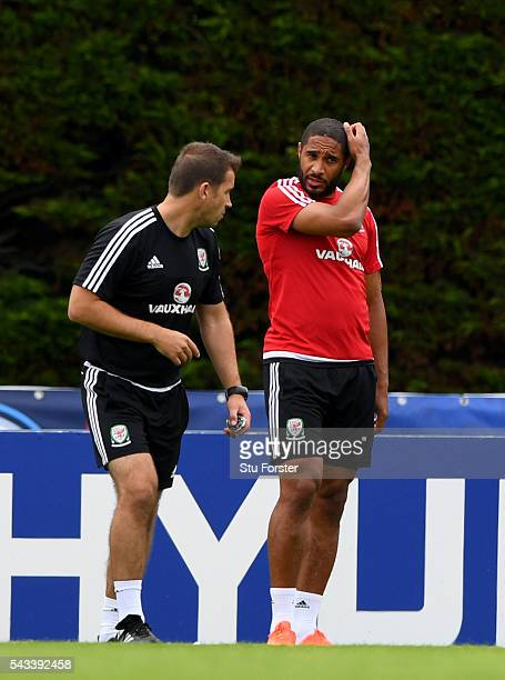 Wales captain Ashley Williams chats with Dr Adam Owen during Wales training at their Euro 2016 base camp ahead of their Quarter Final match against...