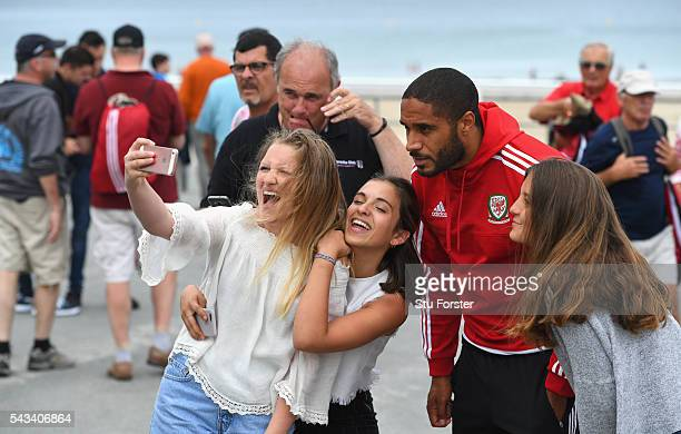 Wales captain Ashley Williams poses for a selfie with locals after a stroll around Dinard town on June 28 2016 in Dinard France