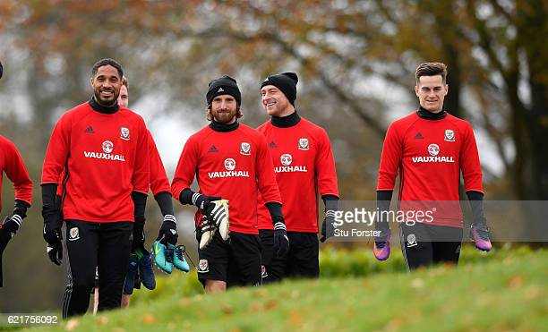 Wales captain Ashley Williams shares a joke with Joe Allen and David Cotterill as the team make their way to training ahead of their World Cup...