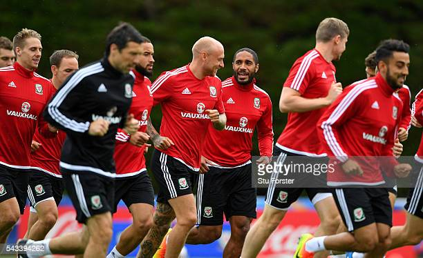 Wales captain Ashley Williams shares a joke with team mates during Wales training at their Euro 2016 base camp ahead of their Quarter Final match...