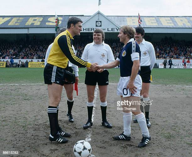 Wales captain Dai Davies meets Scotland's Asa Hartford before the start of their British Championship match at the Vetch Field Stadium in Swansea...