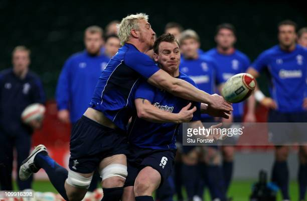 Wales captain Matthew Rees passes the ball despite the attentions of Andy Powell during Wales training at the Millennium Stadium on March 10 2011 in...