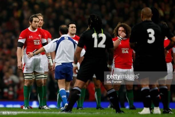 Wales captain Ryan Jones is spoken to by referee Jonathan Kaplan during the Haka before the Invesco Perpetual Series match between Wales and New...