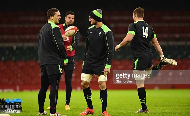 Wales captain Sam Warburton chats with wing George North during Wales captains run session ahead of tomorrows match against the New Zealand All...
