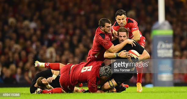 Wales captain Sam Warburton Dan Lydiate and Mike Phillips combine to thwart Richie McCaw of New Zealand during the International match between Wales...