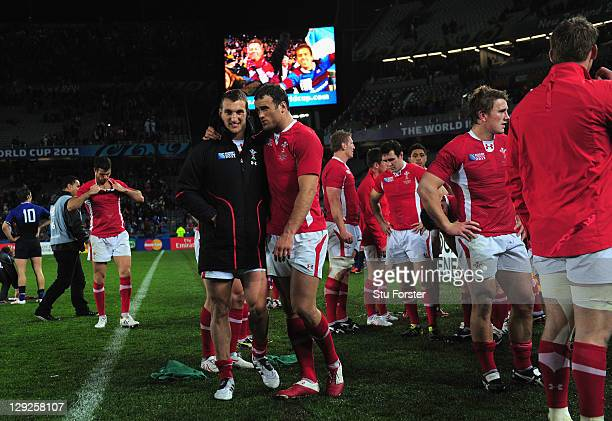 Wales captain Sam Warburton is consoled by teammate Jamie Roberts following their team's 9-8 defeat during semi final one of the 2011 IRB Rugby World...