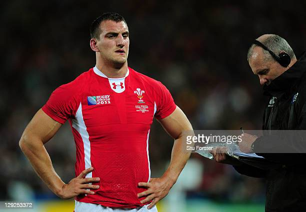 Wales captain Sam Warburton leaves the pitch after receiving a straight red card for a dengerous tackle on Vincent Clerc of France during semi final...