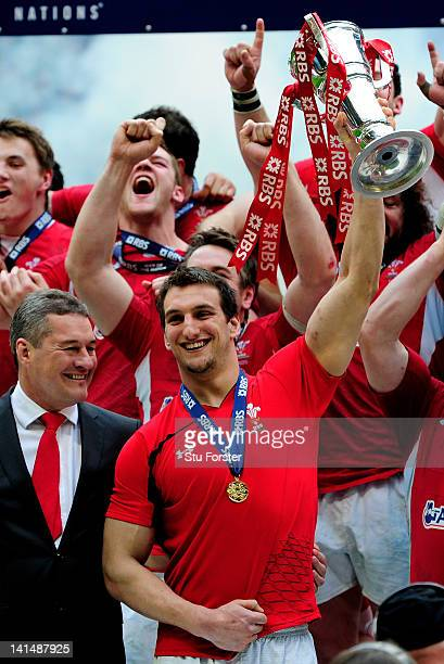 Wales captain Sam Warburton lifts the Six Nations trophy after his team win the match and the Grand Slam during the RBS Six Nations Championship...
