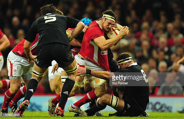Wales captain Sam Warburton runs into All Blacks number 8 Kieran Read during the International Match between Wales and New Zealand at Millennium...