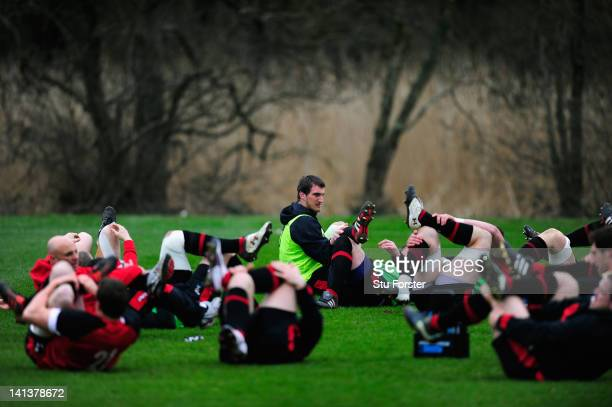 Wales captain Sam Warburton warms up before Wales training at the Vale hotel ahead of this saturdays final RBS Six Nations game against France on...