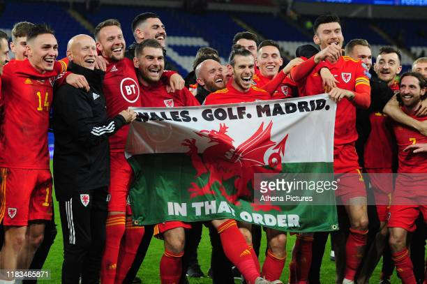 Wales celebrate at full time during the UEFA Euro 2020 Group E Qualifier match between Wales and Hungary at the Cardiff City Stadium on November 19,...