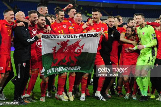 Wales celebrate at full time during the UEFA Euro 2020 Group E Qualifier match between Wales and Hungary at the Cardiff City Stadium on November 19...