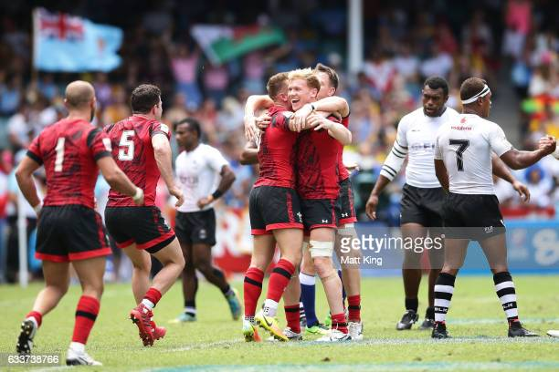 Wales celebrate victory in the mens pool match between Fiji and Wales in the 2017 HSBC Sydney Sevens at Allianz Stadium on February 4 2017 in Sydney...