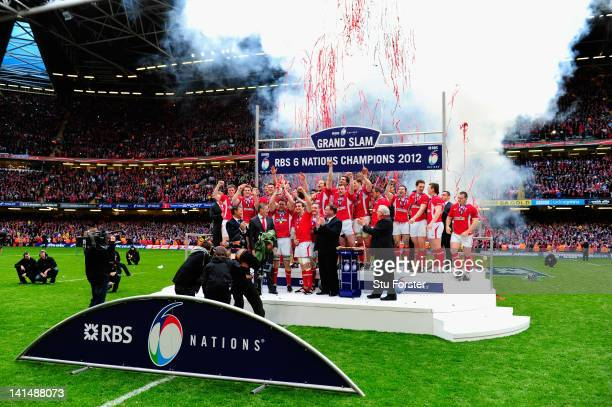 Wales celebrate with the RBS Six Nations trophy after winning the Grand Slam after the RBS Six Nations match between Wales and France at the...