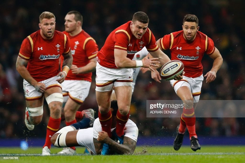 TOPSHOT - Wales' center Scott Williams (C) breaks through the England defence during the Six Nations international rugby union match between Wales and England at the Principality Stadium in Cardiff, south Wales, on February 11, 2017. / AFP PHOTO / Adrian DENNIS / RESTRICTED TO EDITORIAL USE. Use in books subject to Welsh Rugby Union (WRU) approval.
