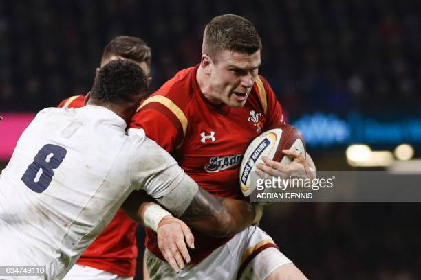 Wales' center Scott Williams is tackled by England's number 8 Nathan Hughes during the Six Nations international rugby union match between Wales and...