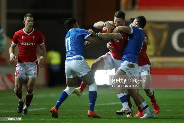 Wales' centre George North gets tackled by Italy's wing Monty Ioane during the Autumn Nations Cup international rugby union match between Wales and...