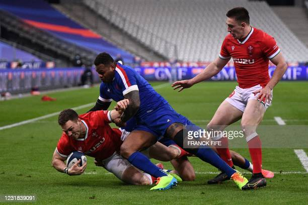 Wales' centre George North is tackled by France's centre Virimi Vakatawa during the Six Nations rugby union tournament match between France and Wales...