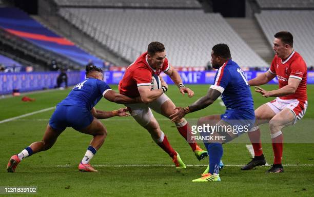Wales' centre George North is tackled during the Six Nations rugby union tournament match between France and Wales on March 20 at the Stade de France...