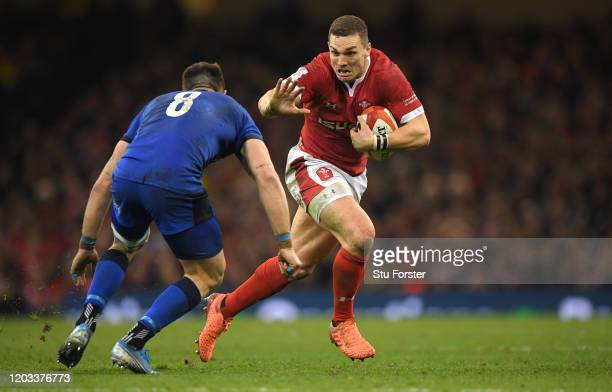 Wales centre George North makes a break past Italy player Abraham Steyn during the 2020 Guinness Six Nations match between Wales and Italy at...