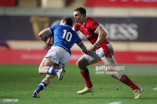 Wales' centre George North tackles Italy's fly-half Paolo Garbisi during the Autumn Nations Cup international rugby union match between Wales and...