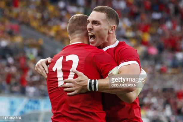 Wales' centre Hadleigh Parkes celebrates with Wales' wing George North after scoring a try during the Japan 2019 Rugby World Cup Pool D match between...