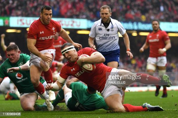 Wales' centre Hadleigh Parkes scores a try during the Six Nations international rugby union match between Wales and Ireland at the Principality...