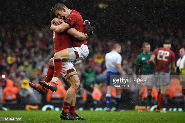 Wales' centre Jonathan Davies and Wales' fullback Liam Williams celebrate after winning the Six Nations international rugby union match between Wales...