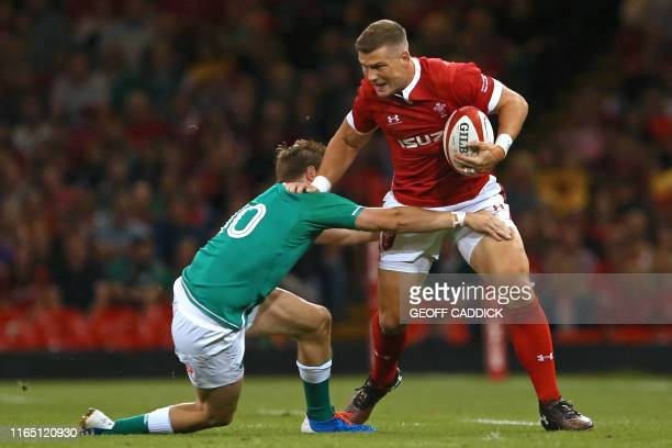 Wales' centre Scott Williams is tackled by Ireland's flyhalf Jack Carty during the international Test rugby union match between Wales and Ireland at...