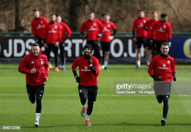 Wales' Chris Gunter Joe Ledley and Aaron Ramsey during a training session at the Vale Resort Hensol