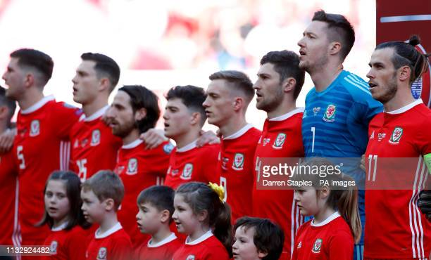Wales' Chris Mepham Jamie Lawrence Joe Allen Daniel James Matthew Smith Ben Davies goalkeeper Wayne Hennessey and Gareth Bale prior to kickoff