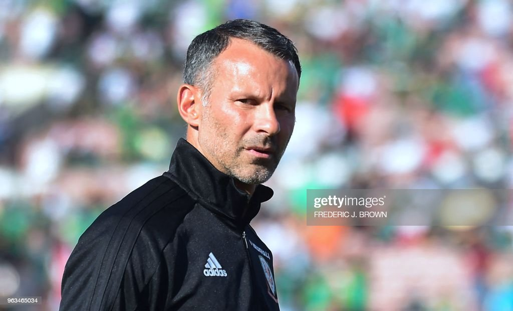 Wales coach and former Manchester United star Ryan Giggs walks off the pitch prior to kickoff against Mexico in an international football friendly at the Rose Bowl in Pasadena, California on May 28, 2018 where the game ended 0-0.