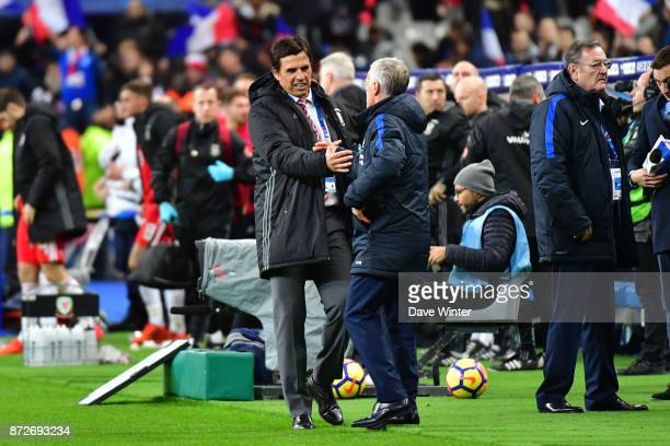 Wales coach Chris Coleman congratulates France coach Didier Deschamps after the international friendly match between France and Wales at Stade de...