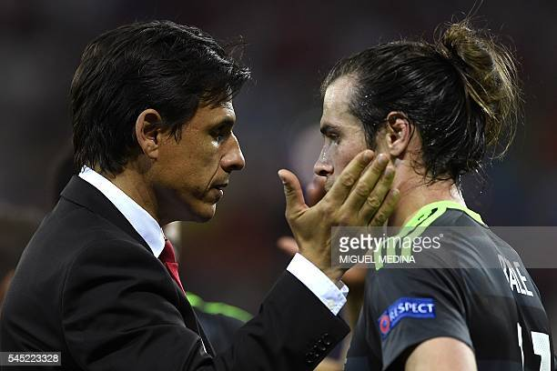 Wales' coach Chris Coleman consols Wales' forward Gareth Bale after Wales lost to portugal 20 in the Euro 2016 semifinal football match between...