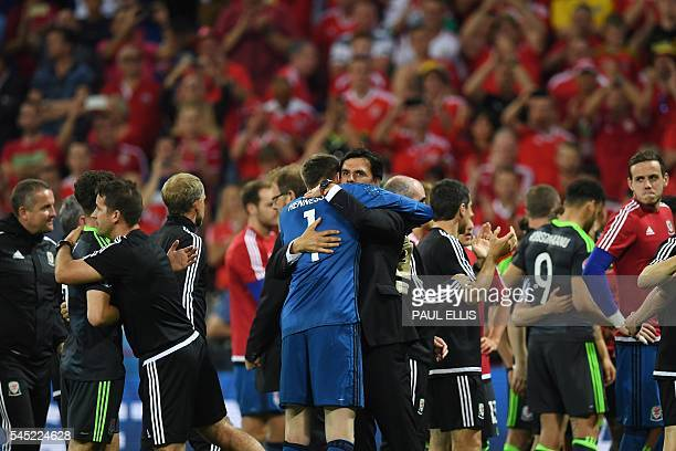 Wales' coach Chris Coleman embraces Wales' goalkeeper Wayne Hennessey at the end of the Euro 2016 semifinal football match between Portugal and Wales...